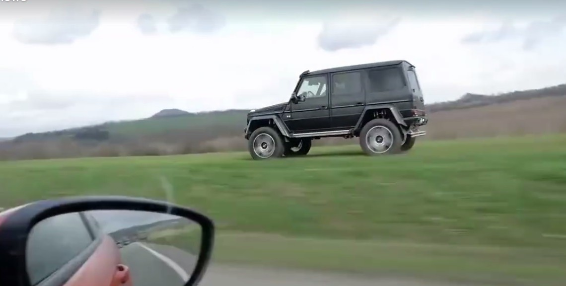 Watch out, it's after you! G-Class in the off-road overtakes car on the road