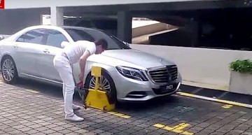Man beats up security guard after his S-Class gets clamped