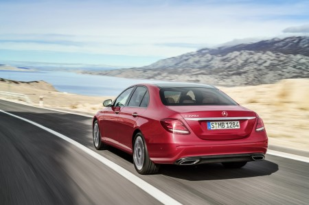 2016-Mercedes-E-Class-E-220-d-rear-three-quarters-Hyazinth-red