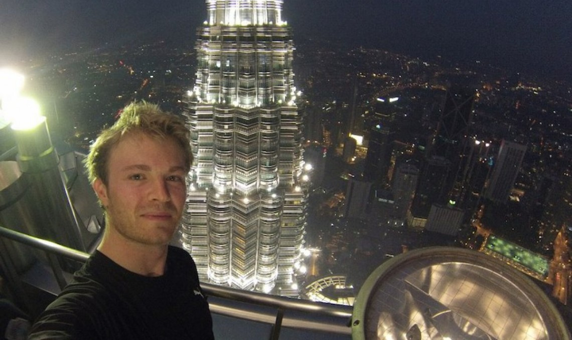 Rosberg runs up the Petronas tower. Isn't the elevator working?