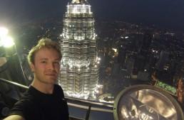Rosberg runs up the Petronas tower. Isn't the elevator working?