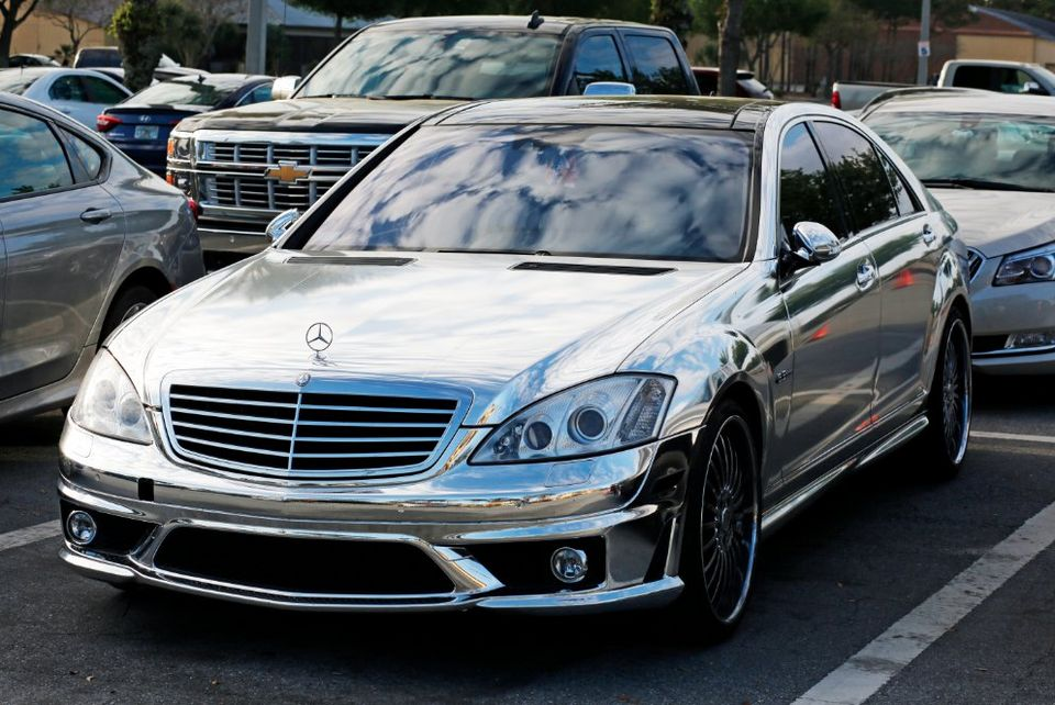 Alfredo Simon drives a chrome Mercedes-Benz