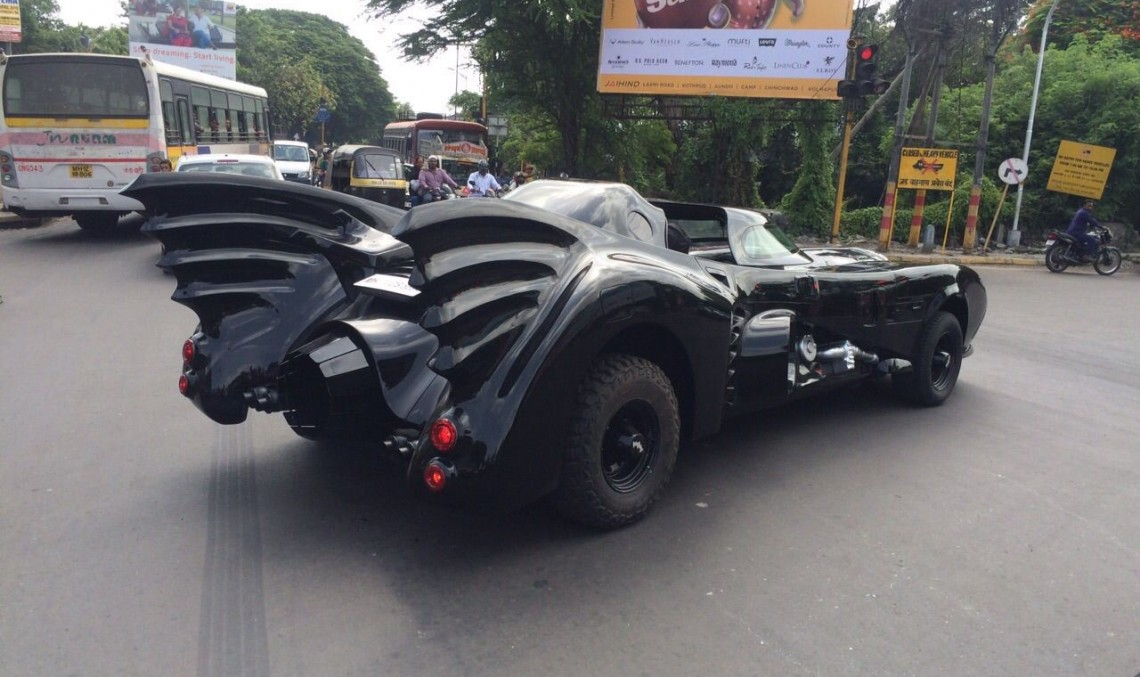 Batman takes his Batmobile for a spin