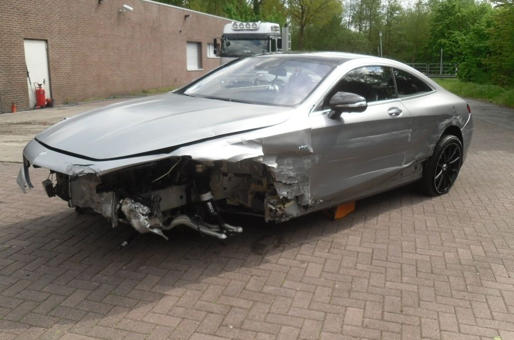 S-Class Coupe costs an arm and a leg. Even when totaled