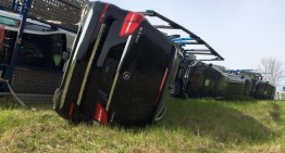 Truck full of Mercedes-Benz cars rolls over