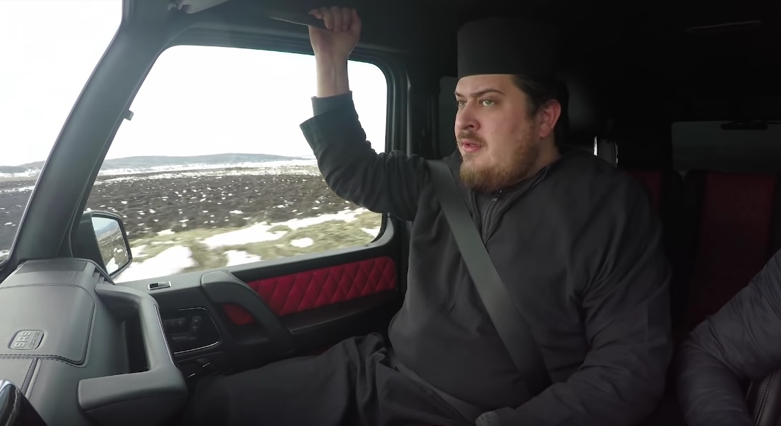 Say your prayers. Priest in a fast ride onboard the G-Class