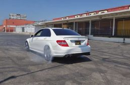 9-year old kid does burnouts with his dad's Mercedes-AMG C 63