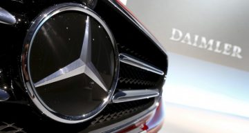 What is Daimler trying to achieve through job cuts?
