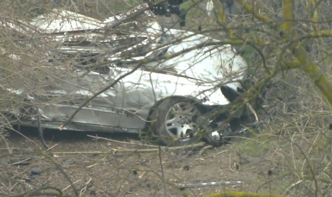 Driver tries to escape the cops, but ends up launching his Mercedes off a cliff