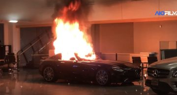 Rioters torch cars in a Mercedes-Benz dealership during protests in the U.S.
