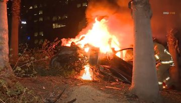 Mercedes-Benz flies off a bridge, catches fire, driver survives